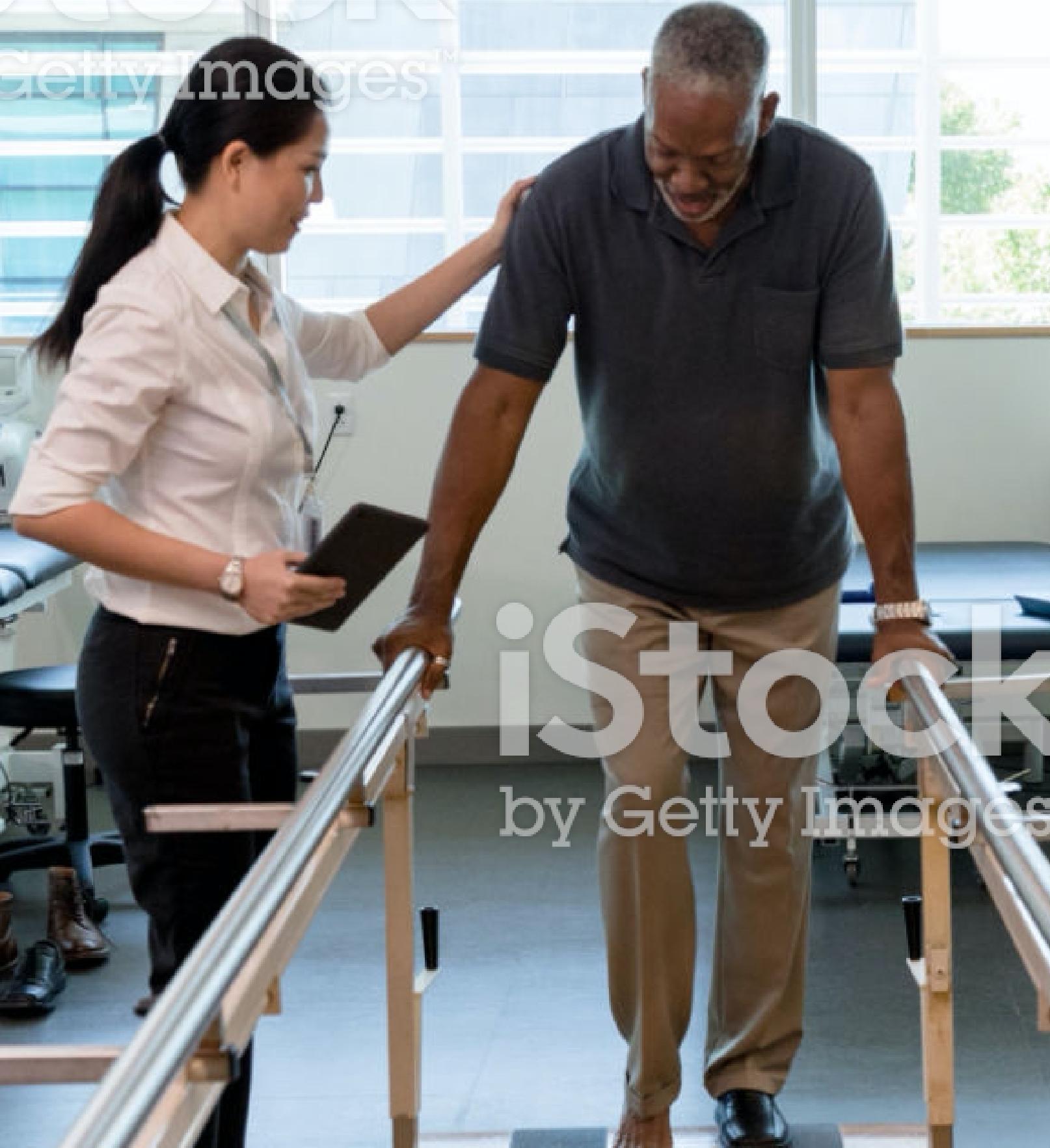 Employee walks with a Female Elderly Patient